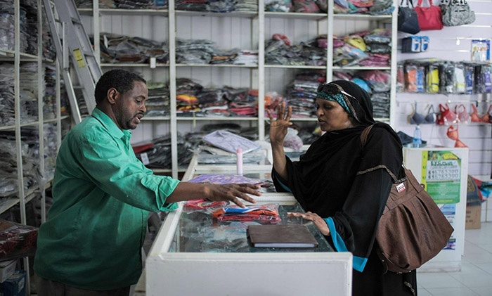 Storeowner and customer in Somalia.jpg